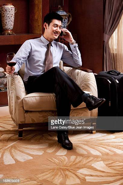 Young businessman using mobile phone in hotel