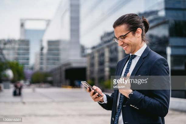 young businessman using smartphone - phone message stock pictures, royalty-free photos & images