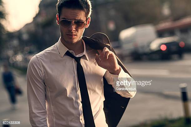 young businessman walking home after work