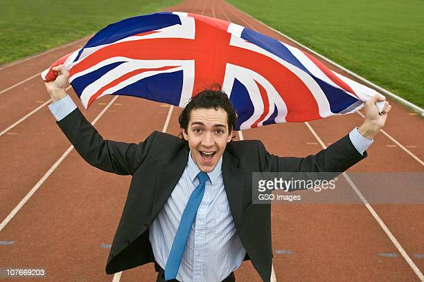 young businessman waves the union jack flag - 2010 stock pictures, royalty-free photos & images