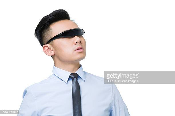 Young businessman wearing a pair of smart glasses