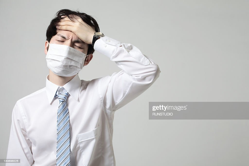 young businessman with a mask,bad condition : Stock Photo