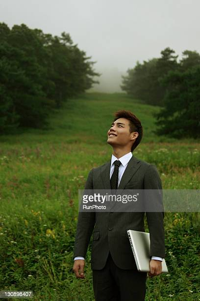 young businessman with a Notebook PC in the forest
