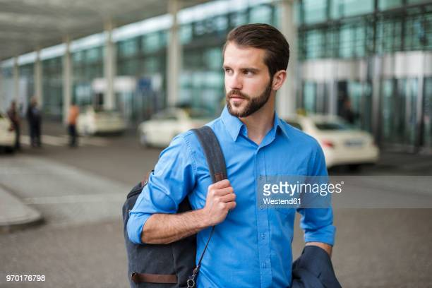 young businessman with backpack on the go - leaving ストックフォトと画像
