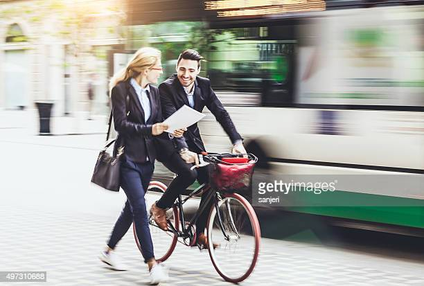 Young businessman with bike on the street