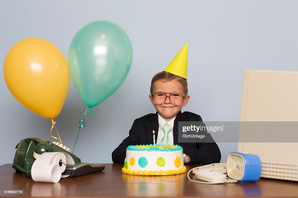 Young Businessman with Birthday Cake at Office Birthday Party : Stock Photo