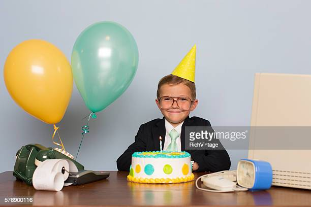 Young Businessman with Birthday Cake at Office Birthday Party