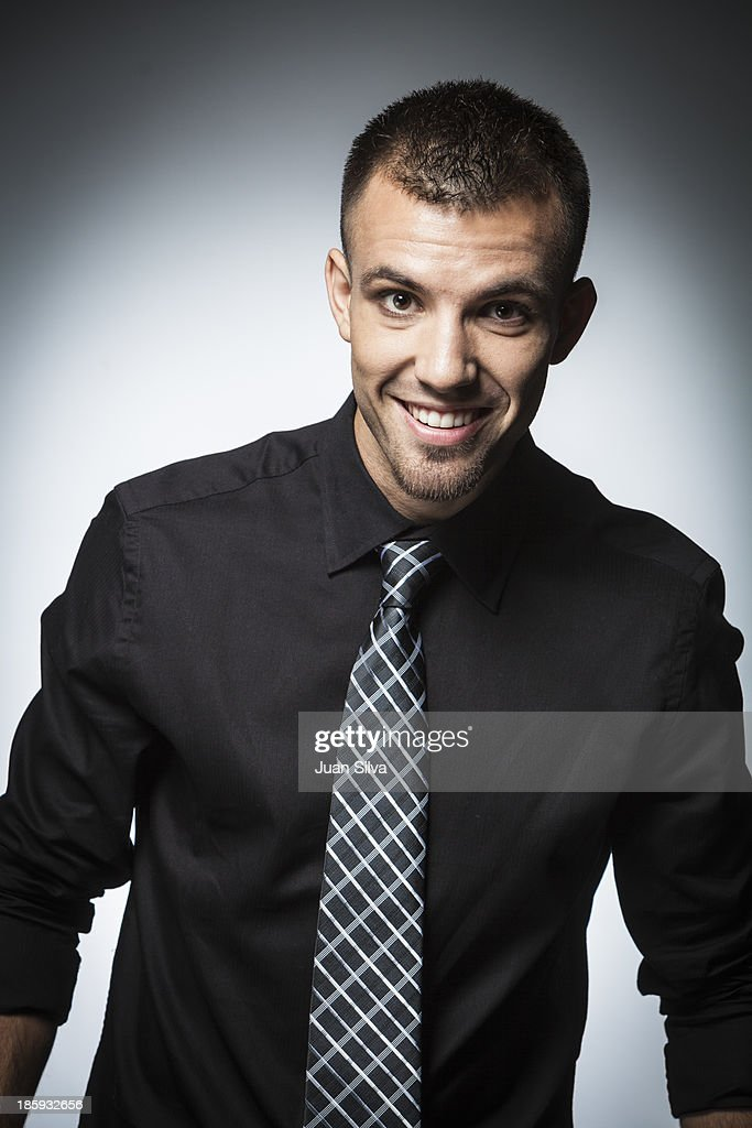 Young Businessman With Black Shirt And Tie Smiling Stock Photo ...