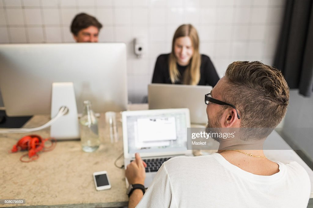 Young businessman with colleagues working in office : Stock Photo