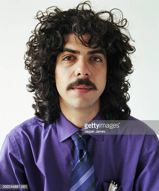 young businessman with curly hair and moustache, portrait, close-up - black hair stock pictures, royalty-free photos & images