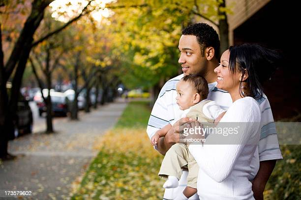 young businessman with finger against his lips - white wife black baby stock photos and pictures