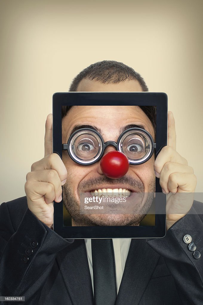 Young Businessman With Funny Face in a Digital Tablet : Stock Photo