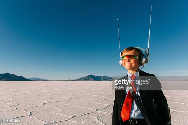 Young Businessman with Headset and Sunglasses at Salt Flats