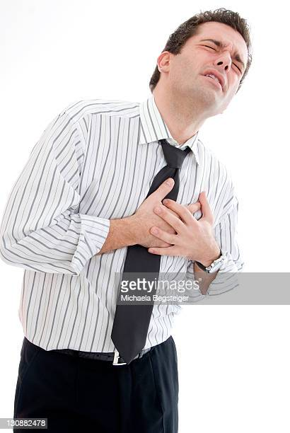 young businessman with heartache - cardiac arrhythmia stock pictures, royalty-free photos & images
