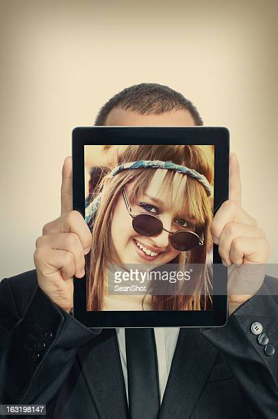 young businessman with hippie girl in a digital tablet - happy clown faces stock photos and pictures