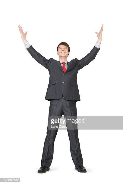 Young businessman with his arms extended