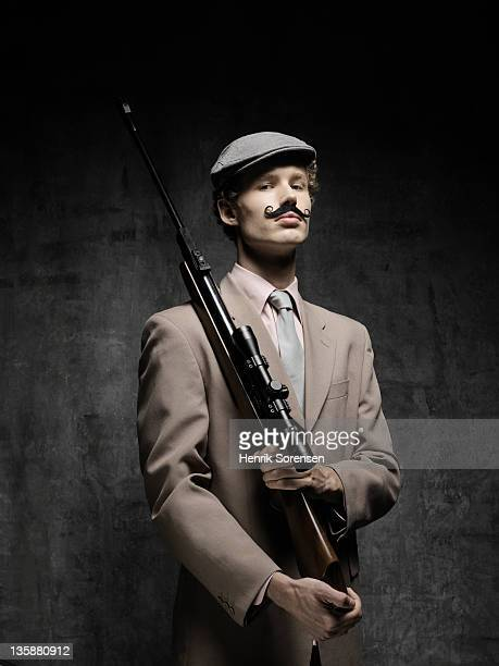 young businessman with moustache and riffle