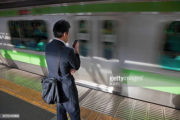 Young Businessman with Smartphone at Yoyogi Station in Tokyo, Japan