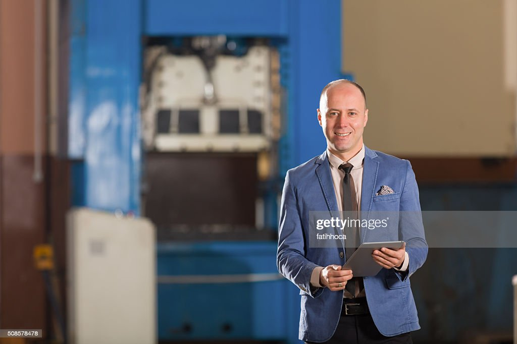 Young Businessman with Tablet : Stock Photo