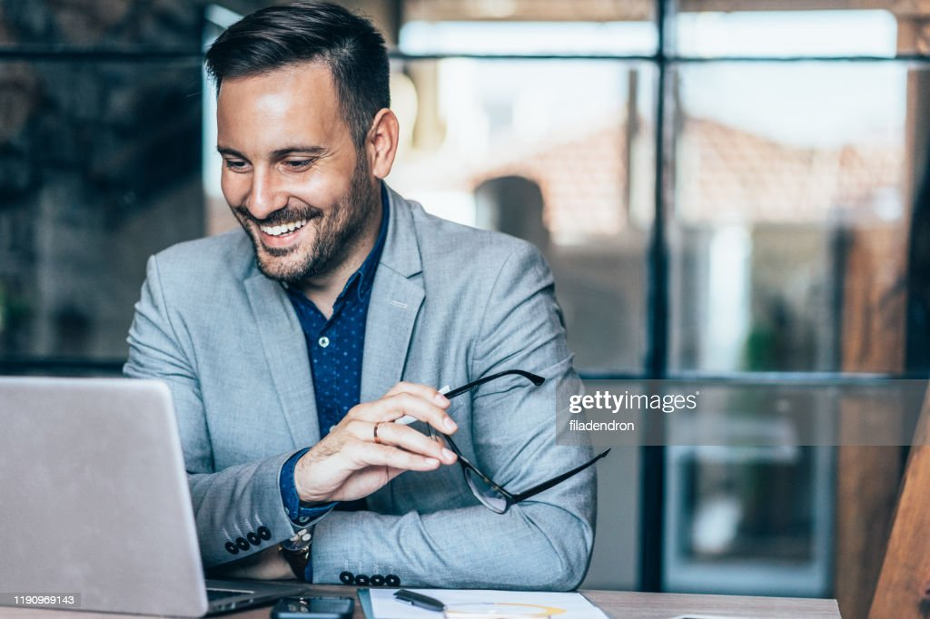 Young businessman working at office : Foto de stock