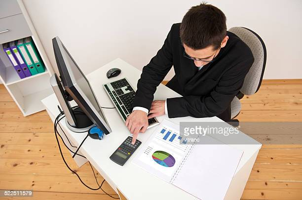 Young businessman working from home