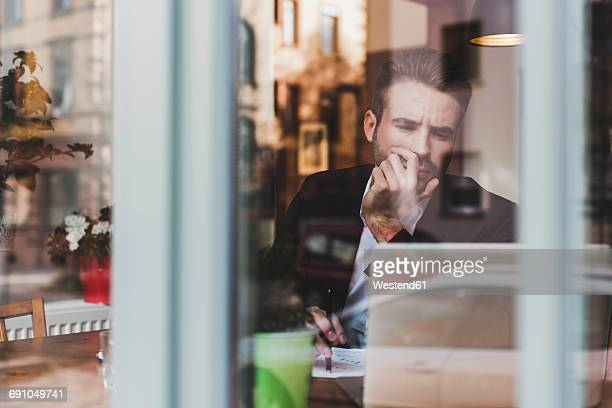 Young businessman working in a cafe
