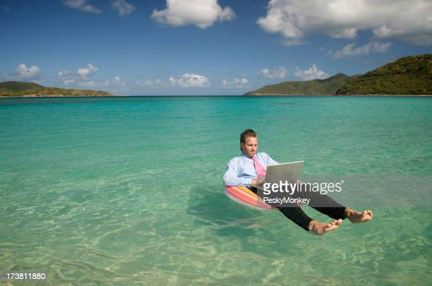 Young Businessman Working Island Style Relaxing in Sea