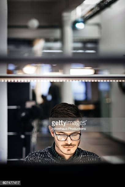 Young businessman working late in office