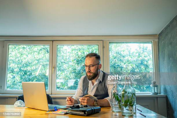 young businessman working on the laptop in a cafe - dusan stankovic stock pictures, royalty-free photos & images
