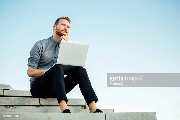Young businessman working outdoor