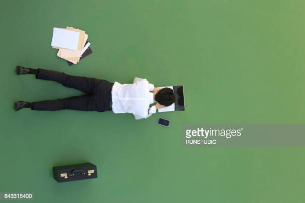 Young businessman working with a laptop on the floor