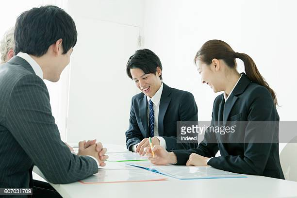 Young businessmen and woman talking at table
