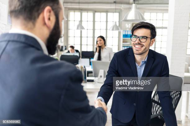 young businessmen in handshake - candidate stock pictures, royalty-free photos & images