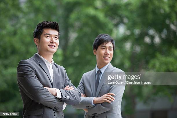 Young businessmen looking at view