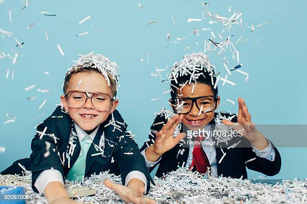 young businessmen partying with shredded paper - shredded stock pictures, royalty-free photos & images