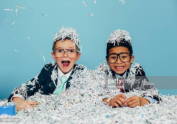 Young Businessmen Partying with Shredded Paper