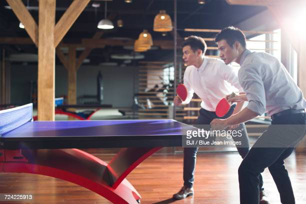 young businessmen playing ping pong - doubles stock photos and pictures