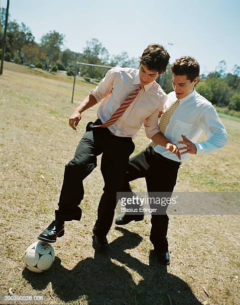 young businessmen playing soccer, wearing shirts and ties - blasius erlinger stock pictures, royalty-free photos & images