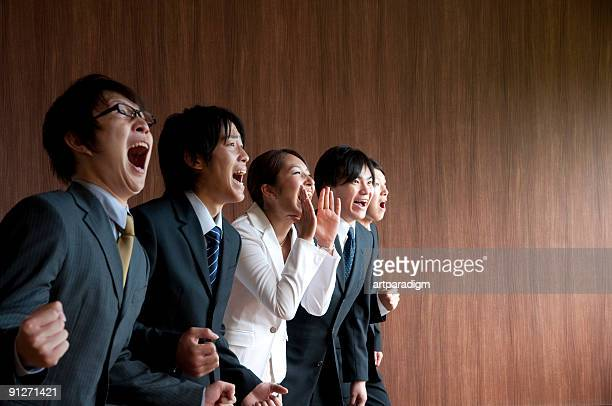 Young businessmen shouting