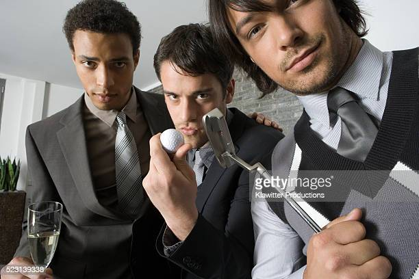 Young Businessmen with Champagne and Putter