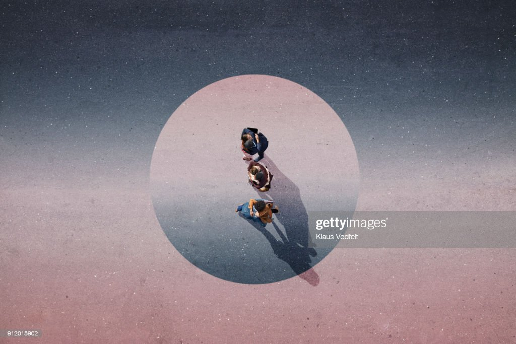 Young businesspeople hugging. Standing in painted circle on asphalt : Stock Photo