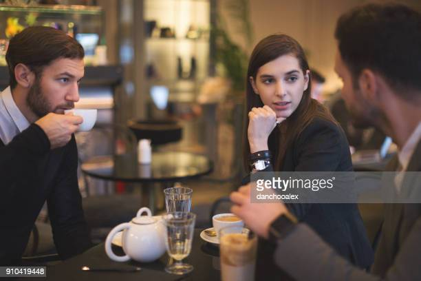Young businesspeople working in restaurant