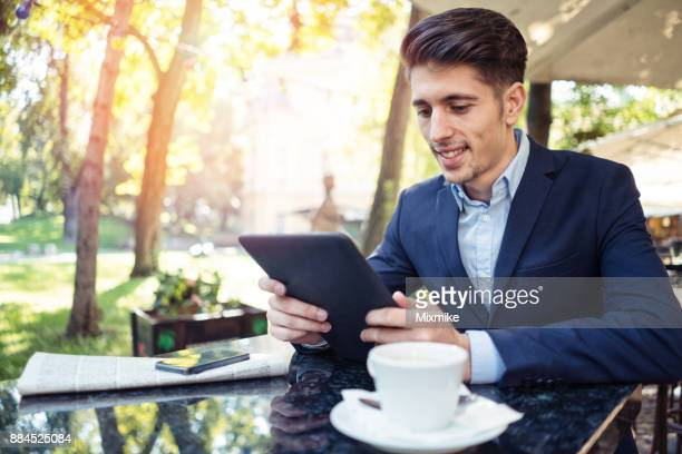 Young businessperson browsing on his tablet