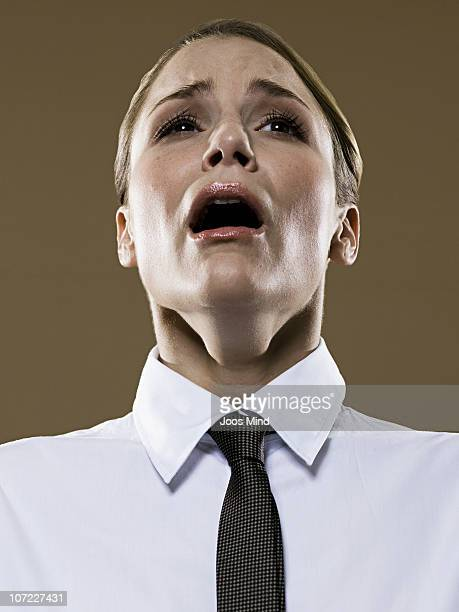 young businesswoman about to sneeze, portrait - mouth open stock pictures, royalty-free photos & images