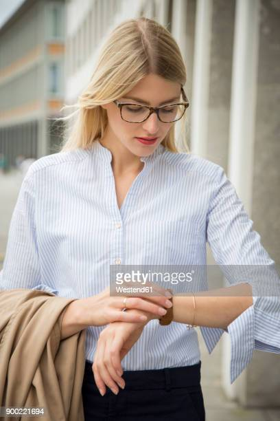 young businesswoman checking the time - looking down her blouse stock photos and pictures