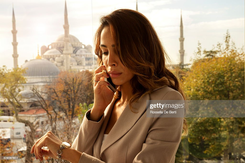 Young Businesswoman Checking Time At Sunset : Stock Photo