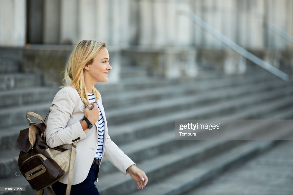Young businesswoman commuting to work. : Stock Photo