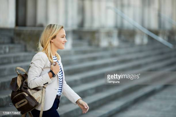 young businesswoman commuting to work. - universidad stock pictures, royalty-free photos & images