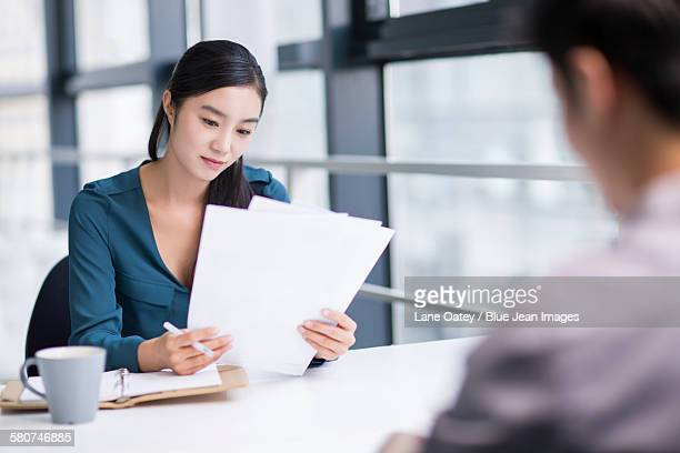 Young businesswoman conducting job interview
