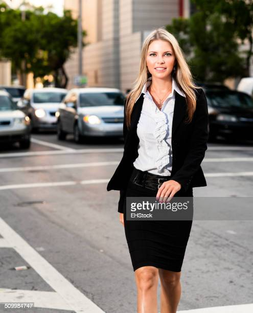 Young Businesswoman Crossing Street